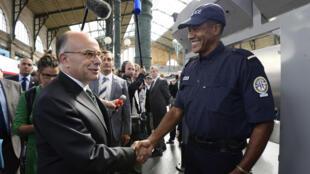 French Interior Minister Bernard Cazeneuve meets police patrolling Paris's Gare du Nord last month
