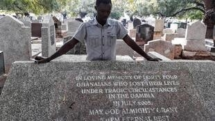 Massacre survivor Martin Kyere at Accra cemetery where six bodies were returned from Gambia.