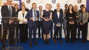 Les lauréats et leurs parrains des 7e Trophées des Français de l'étranger.