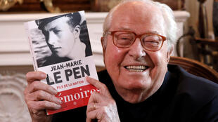 Jean-Marie Le Pen, founder of France's far-right National Front political party, holds his book of memoirs in Montrerout, France, February 27. 2018.