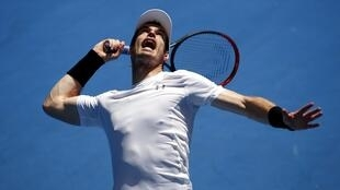 Britain's Andy Murray serves during a practice session at Melbourne Park, Australia