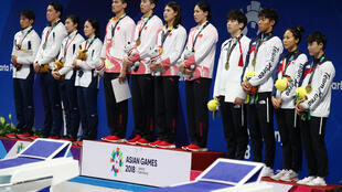 Swimming - 2018 Asian Games - Mixed 4 x 100m Medley Relay Final Jakarta, Indonesia - August 22, 2018 Silver medalists of team Japan, gold meadlists of team China and bronze medalists of team South Korea during the medals ceremony