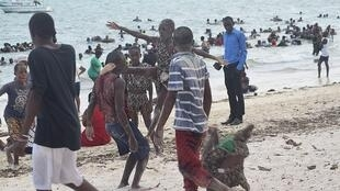 Kids playing at a beach in Mombasa