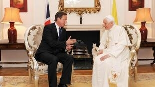 Britain's Prime Minister David Cameron speaks to Pope Benedict XVI during a meeting at Archbishop's House, near Westminster Cathedral in central London, 18 September