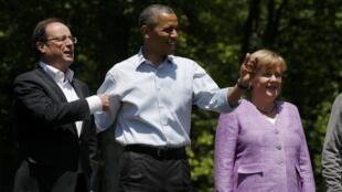 Da esquerda para a direita, François Hollande, presidente francês, Barack Obama, presidente americano e a chanceler alemã Angela Merkel durante encontro do G8 em Camp David.