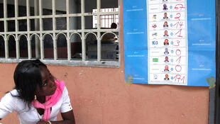 Noting down voting tallies at the Don Bosco centre polling station in Masina, Kinshasa