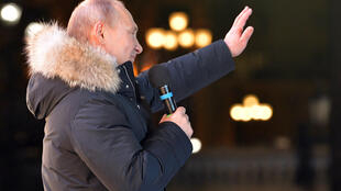Russian President Vladimir Putin speaks to supporters on polling day