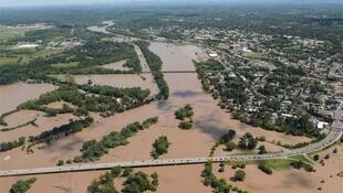 An aerial view of Route 5 between Scotia to Schenectady, New York is overrun by flood waters from the Mohawk Rive