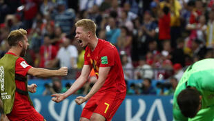 Belgium's Kevin De Bruyne celebrates after the match with Dries Mertens
