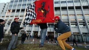 A silent vigil outside of the hospital where Schumacher remains in a critical state