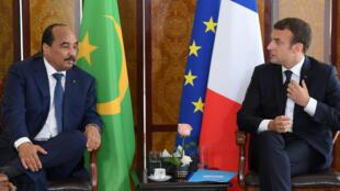L«'Alliance pour le Sahel» est l'initiative lancée par Emmanuel Macron (G), ici avec le président mauritanien (G), lors du G5 Sahel le 2 juillet 2017.