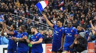French players celebrate after defeating England 22-16 in their Six Nations rugby match.
