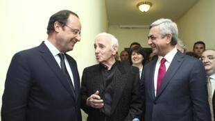François Hollande with Armenian President Serge Sarkissian and singer Charles Aznavour (C) on Monday