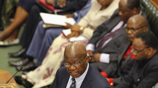 Zimbabwe's Finance Minister Patrick Chinamasa presents the country's 2014 budget to Parliament in Harare, 19 December, 2013