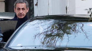 Former French President Nicolas Sarkozy enters his car as he leaves his house in Paris, France, March 21, 2018.