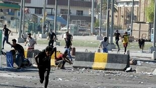 Anti-government protesters hit the streets of Baghdad in defiance of a curfew.