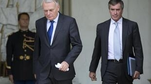 Prime Minister Jean-Marc Ayrault (L) and Budget Minister Jerome Cahuzac leaving the Council of Ministers