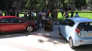 People gathering at an environmental vehicle event in Sacramento, California