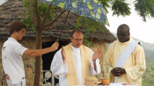 French Catholic priest Georges Vandenbeusch celebrates mass in his parish in north Cameroon