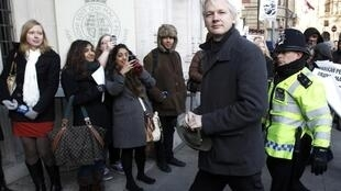 WikiLeaks founder Julian Assange arrives at the Supreme Court in London 1 February 2012