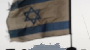 Mavi Marmara seen in the background of the Israeli warship on 31 May, 2010