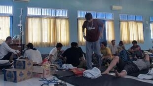 The asylum-seekers, housed in a community hall in Indonesia