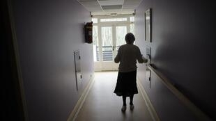 A woman suffering from Alzheimer's disease, in a retirement home in France.