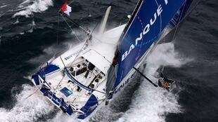 """French skipper Armel le Cleac'h sails onboard his """"Banque Populaire"""" monohull on September 24, 2012 off the coast of Lorient, western France."""