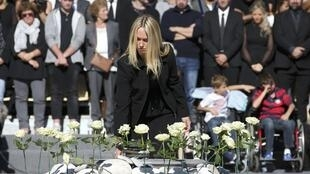 White roses are placed during the ceremony in tribute to the victims and the families of the fatal truck attack three months after hte Nice attack