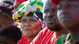 Supporters listen to a speaker during a May Day rally in Durban, South Africa.