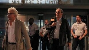 Former head of European football association UEFA Michel Platini, right, and his lawyer William Bourdon leave a Paris-region judicial police station where Platini was detained for questioning, 19 June 2019.