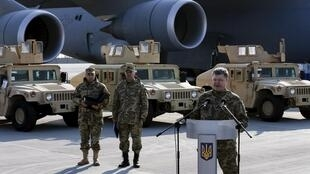 Ukraine's President Petro Poroshenko at a welcome ceremony for the delivery of 10 Humvee vehicles from the US on 25 March 2015