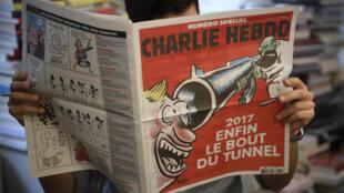 """A nova capa do semanário satírico francês Charlie Hebdo """"Enfim o fim do túnel"""""""