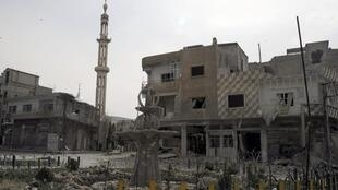 Damaged buildings at Yabroud town at the Damascus countryside, 16 March 2014.