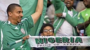 Nigeria fans cheer ahead of the friendly match between Nigeria and Scotland at Craven Cottage in London, 28 May, 2014