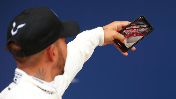 Lewis Hamilton celebrated is first pole position since the Australian Grand Prix with a selfie in the Mercedes team paddock.