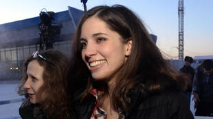 Pussy Riot's Nadia Tolokonnikova with Maria Alekhina at Krasnoyarsk airport after their release