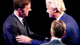 Primeiro - ministro holandês, Mark Rutte, e o seu principal adversário, Geert Wilders, líder do Partido para a Liberdade (PVV)