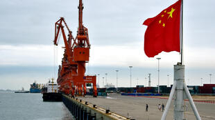 A Chinese national flag is seen at a port in Beihai, Guangxi province, China June 17, 2017. Picture taken June 17, 2017.