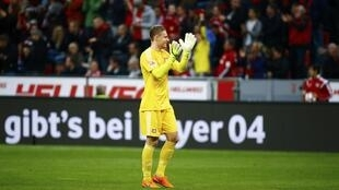 Bayer Leverkusen goalkeeper Bernd Leno celebrates after his side became only the third team to beat Bayern Munich in the Bundesliga this season