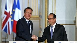 French President Francois Hollande shakes hands with Britain's Prime Minister David Cameron at the Elysee Palace in Paris on Monday.