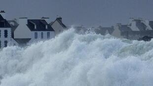 Waves crash into the seafront of Penmarch