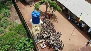 A water tank built by TEAM donations in Benin