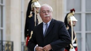 The late CEO Christophe de Margerie, seen here at the Elysée palace, denied that Total had paid bribes in the case before his death last month