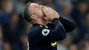 Wayne Rooney celebrates after scoring for Everton against Mancheter City last year