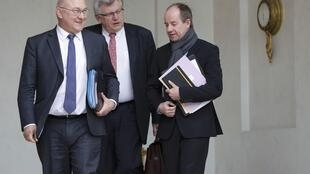 French Finance Minister Michel Sapin, Junior Minister for Budget Christian Eckert and Justice Minister Jean-Jaques Urvoas leave the Elysee Palace