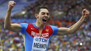 Aleksandr Menkov celebrates after winning the men's long jump final