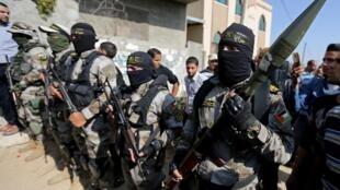 Des militants du Jihad islamique palestinien participent aux funérailles de leur camarade dans le sud de la bande de Gaza le 14 novembre 2019.
