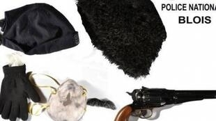 Disguises and gun allegedly used by the former journalist turned armed robber.
