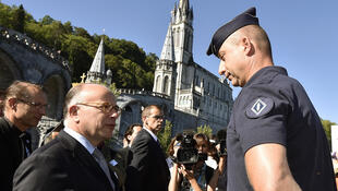 French Interior Minister Bernard Cazeneuve with some of the 508 security force members at Lourdes on Monday
